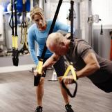 Training someone on a TRX to do pushups
