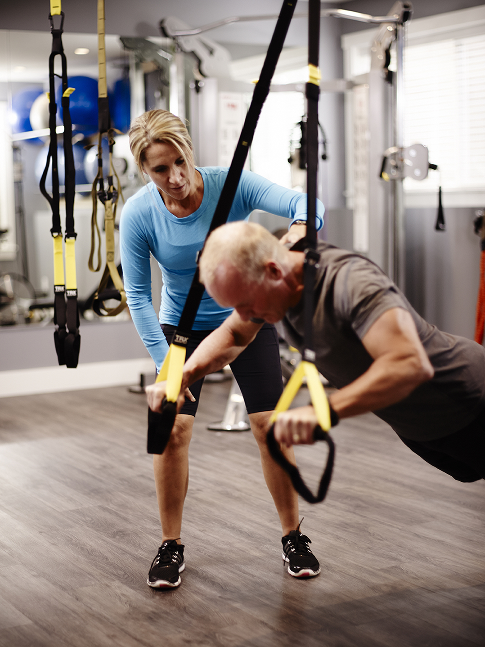 Push-ups using a TRX